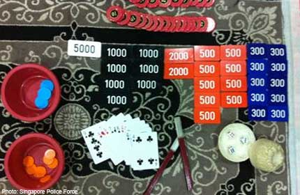 POLICE BUST ILLEGAL GAMBLING DEN