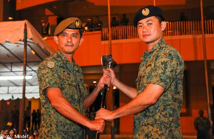 NEW CHIEF GUARDS OFFICER FOR SINGAPORE