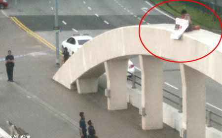WOMAN ARRESTED FOR PROTESTING ON TOP OF BRIDGE NEAR ICA BUILDING