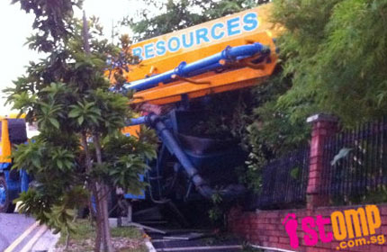 Singapore Crane Accident Picture on Crane Rolls Into Siglap Home