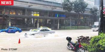 Shenton Way hit by flash flood
