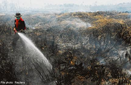 Singapore puts heat on Indonesia to take on haze situation
