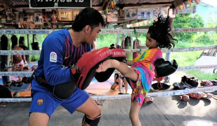 Mussalin Yoohanngoh, nine,trains with one of her brothers