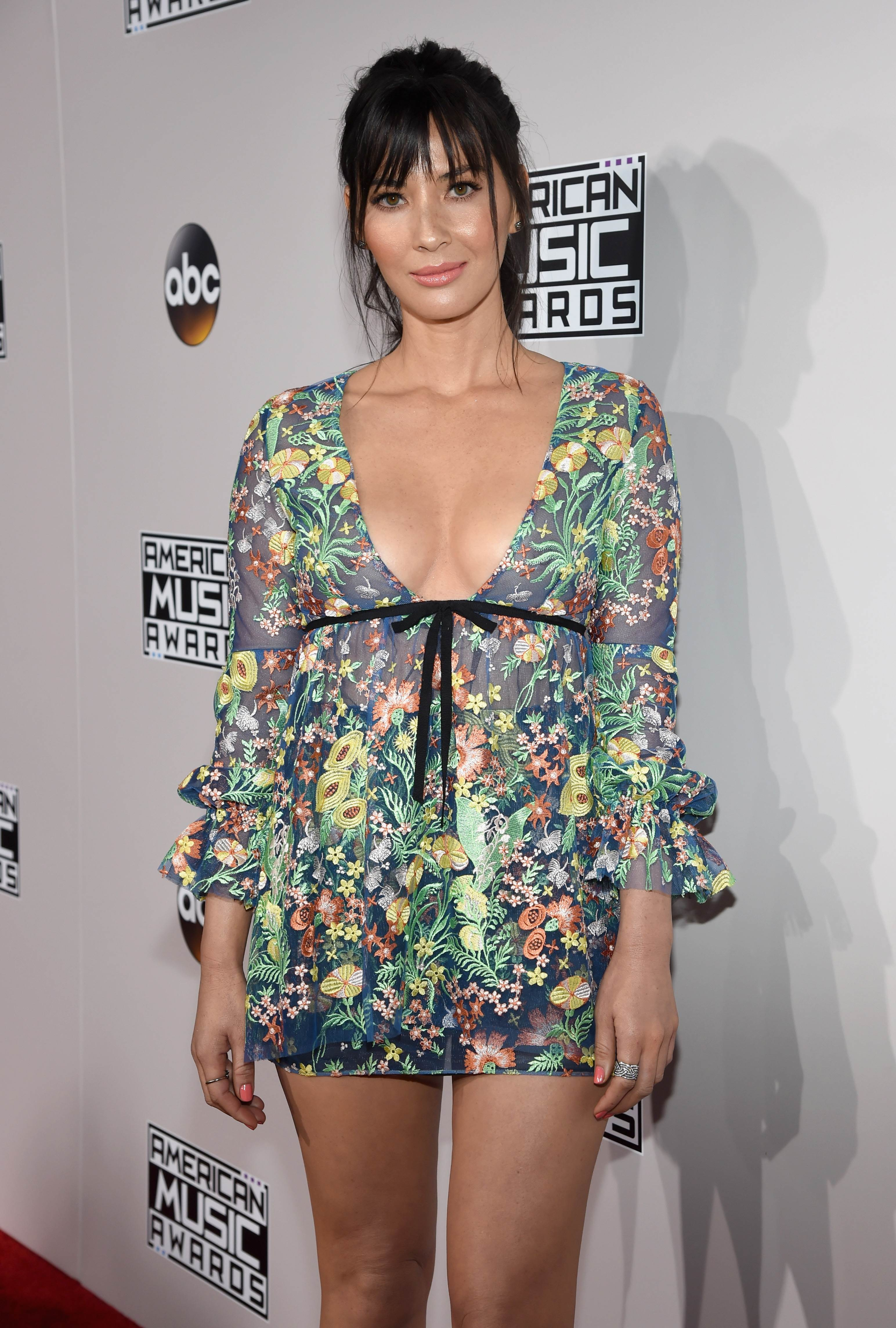 Celebrities show off lots of cleavage and legs at American
