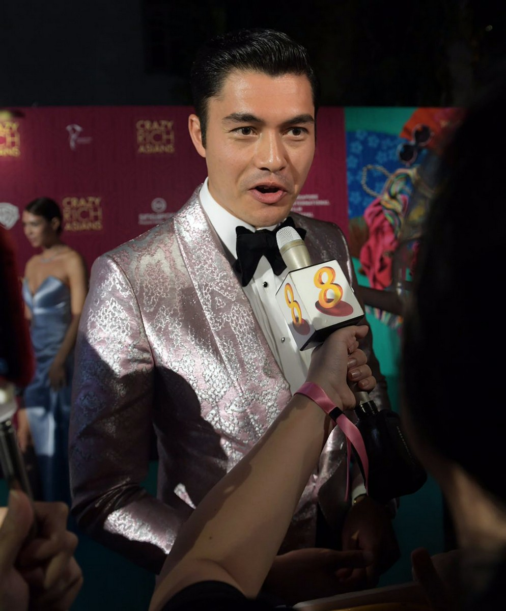 Actor Henry Golding (R) and his wife Liv Lo (L) arrive at the film premiere  of