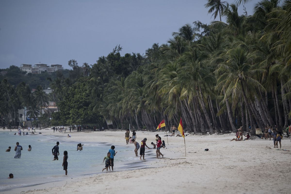 As visitors return to Boracay resort island, so do the piles