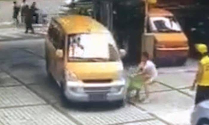 Guangzhou woman pushes son towards oncoming van in 'crash