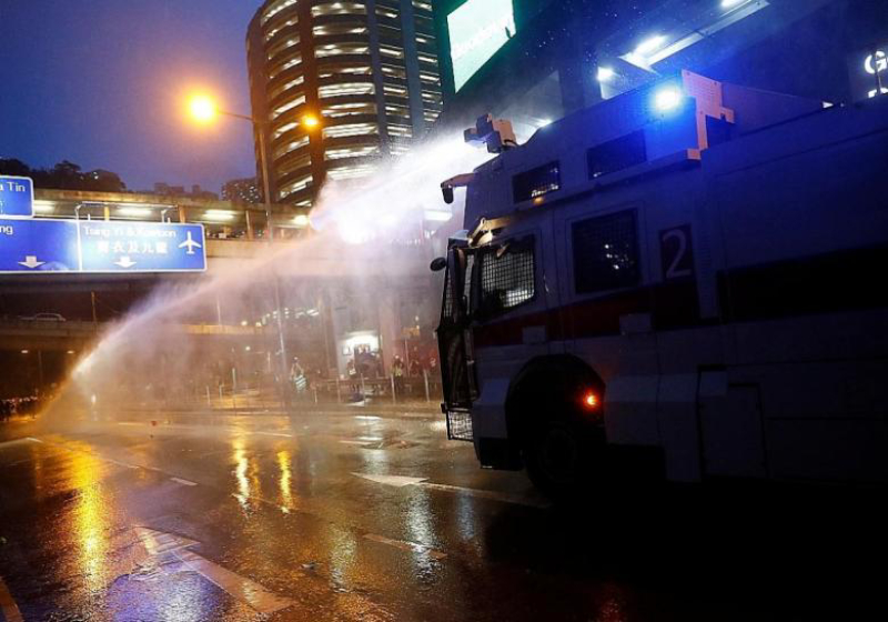 Hong Kong police turn water cannon on protesters, fire tear