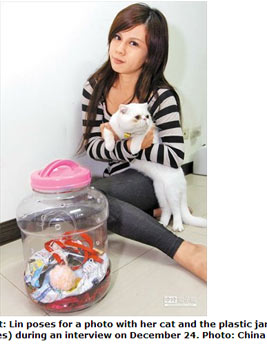 College student who put cat in jar charged with abuse, Asia News