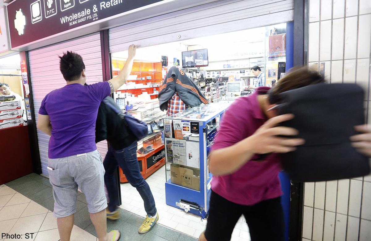 Police investigating 2 more shops in Sim Lim Square