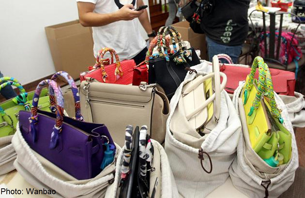 Woman's branded goods seized over GST, Singapore News - AsiaOne