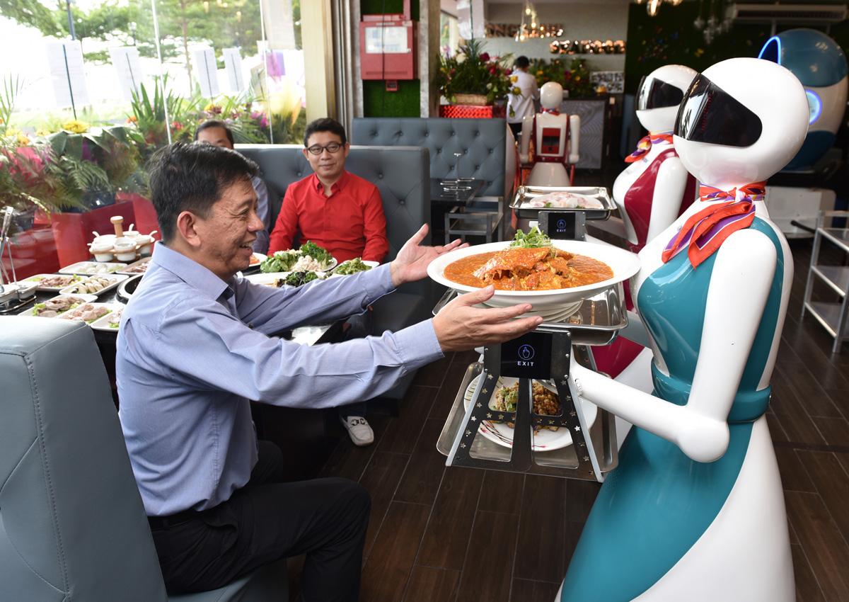 Singapore restaurant 'hires' robot waiters