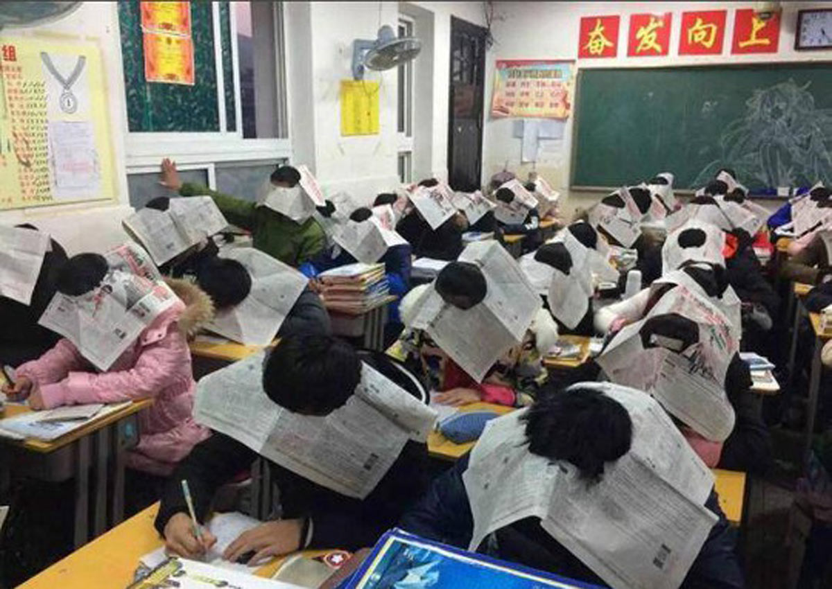 Chinese school stops exam cheating by using a newspaper 'device