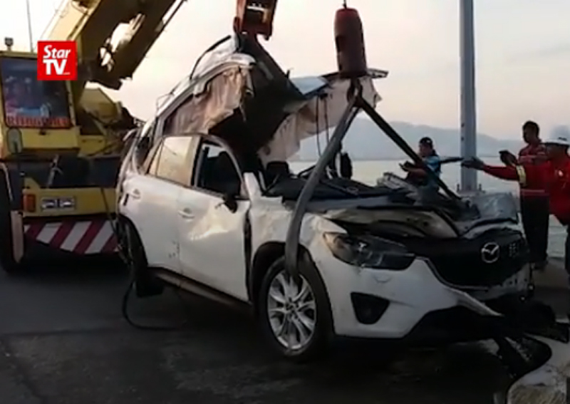 Penang Bridge crash: Solemn scene after rescuers recover SUV with body of driver inside ...
