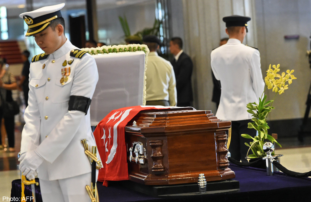 Body to lie in state after solemn journey , Singapore News