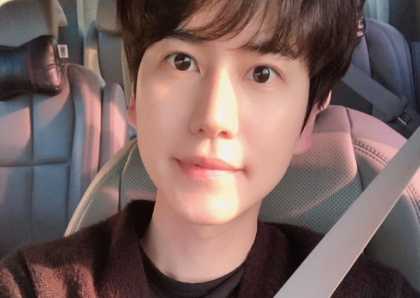 Super Junior finally reunited as Kyuhyun completes military service