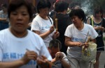 Chinese families mark 100th day of MH370's disappearance - 3