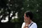 Chinese families mark 100th day of MH370's disappearance - 6