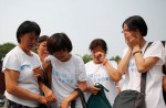 Chinese families mark 100th day of MH370's disappearance - 10