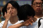 Chinese families mark 100th day of MH370's disappearance - 5