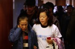 Chinese relatives' anger erupts in Malaysia over lost plane - 32