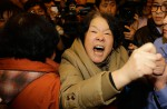 Chinese relatives' anger erupts in Malaysia over lost plane - 18