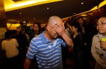 Chinese relatives' anger erupts in Malaysia over lost plane - 22