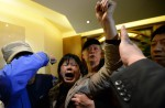 Chinese relatives' anger erupts in Malaysia over lost plane - 19