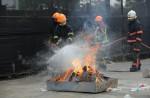 Khaw Boon Wan's Facebook photos of mock riot draw flak - 3