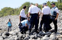 New debris found on island in hunt for MH370 answers