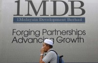 3 people linked with agencies probing 1MDB arrested