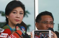 Ex-Thai PM Yingluck appears in court over doomed rice subsidy scheme