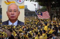 Police offer reward for info on Najib-Hadi picture stompers