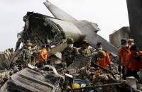 Military plane transporting bodies of crash victims aborts flight twice