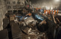 Eleven dead in China building collapse, three missing