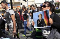 Merkel says Germany can cope with refugees without raising taxes