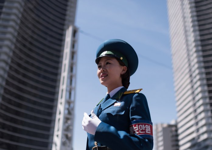 DRIVEN TO DISTRACTION: PYONGYANG'S 'TRAFFIC LADIES' Nkrtrafficladies_140617_afp