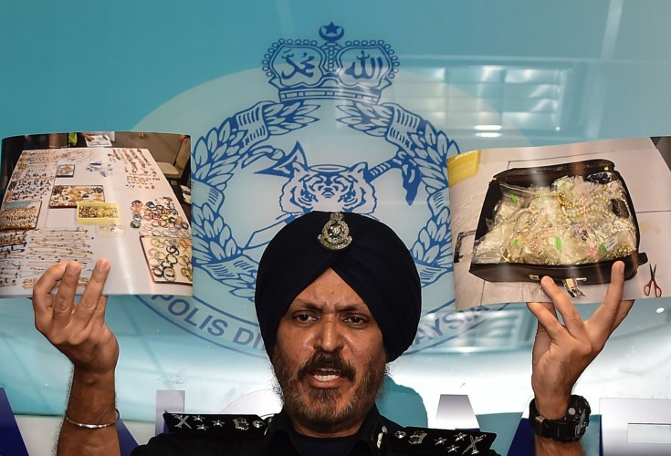 Police reveal huge haul of valuables found at Najib homes