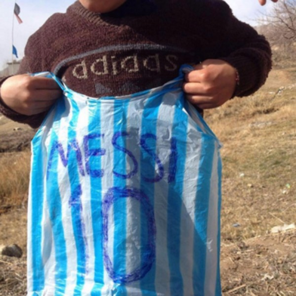 Barcelona star Lionel Messi is hoping to arrange a meeting with an Afghan  boy who shot to fame after pictures of him dressed in a striped plastic bag  jersey ...
