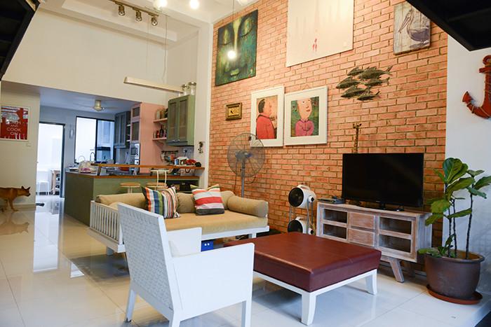 Tropical resort meets industrial in couple's 3-storey