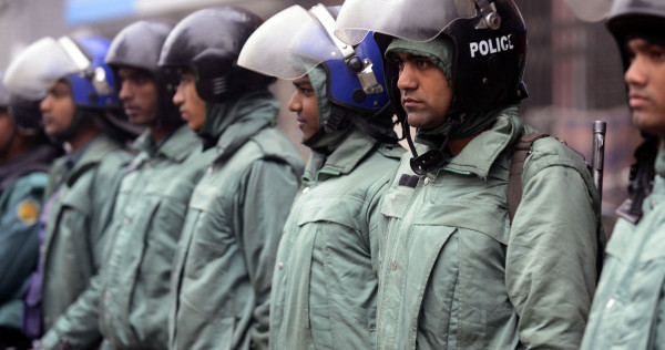 Bangladesh police lock opposition leader in office, ban protests