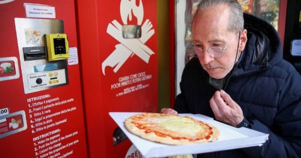 Pizza vending machine prompts curiosity and horror in Rome, World News