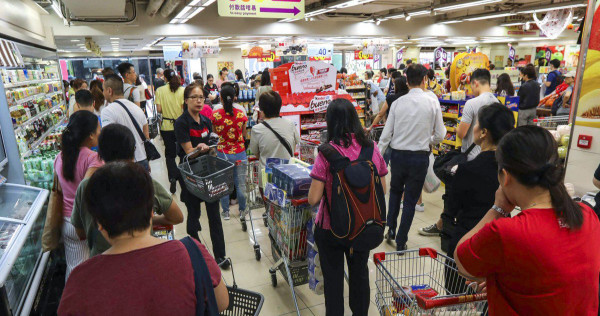 Hong Kong shoppers panic buy as city struggles to cope with