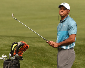 Golf: The game goes on without Woods, though not quite the same