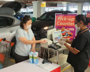 Malaysia supermarket provides drive-through service during lockdown