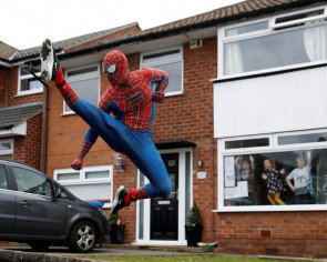 Spider-Man to the rescue! Superhero jogger cheers kids in England