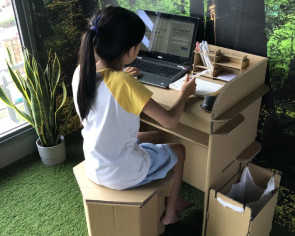 This cardboard desk gives each family member their own WFH space
