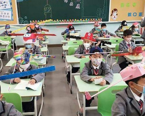 Coronavirus: Chinese school gives pupils a hat tip to teach them how to keep their distance