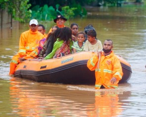 Floods and landslides kill dozens in Indonesia and East Timor