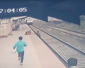 'Superhero' railway worker in India saves boy from oncoming train